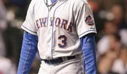 New York Mets' Curtis Granderson reacts after striking out during the sixth inning of a baseball game against the Chicago Cubs in Chicago, Wednesday, June 4, 2014. (AP Photo/Nam Y. Huh)