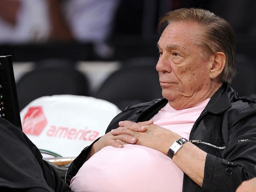 FILE - In this Oct. 17, 2010 file photo, Los Angeles Clippers team owner Donald Sterling watches his team play in Los Angeles. Sterling agreed Wednesday June 4, 2014 to sign off on selling the team he has owned for 33 years to former Microsoft CEO Steve Ballmer for $2 billion, bringing the possibility of a resolution to weeks of rumors, uncertainty and looming possibilities for legal action.  (AP Photo/Mark J. Terrill, File)