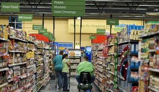Customers shop at Wal-Mart Neighborhood Market in Bentonville, Ark., Thursday, June 5, 2014. (AP Photo/Sarah Bentham) ** FILE **
