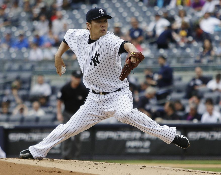 New York Yankees' Masahiro Tanaka, of Japan, delivers a pitch during the first inning of a baseball game against the Oakland Athletics Thursday, June 5, 2014, in New York. (AP Photo/Frank Franklin II)