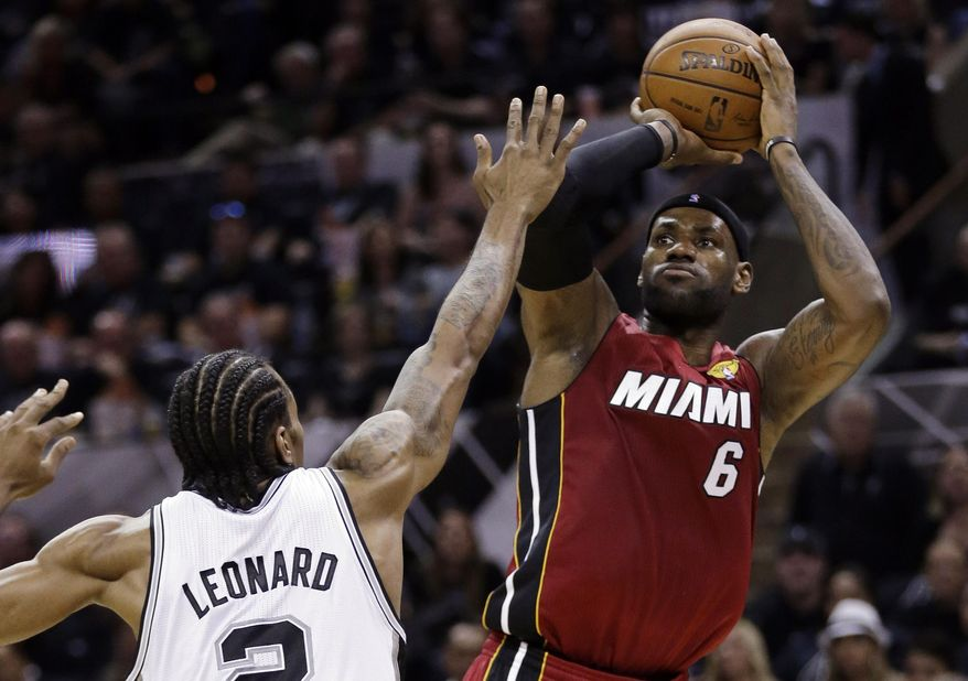 Miami Heat forward LeBron James (6) shoots over San Antonio Spurs forward Kawhi Leonard (2) during the first half in Game 1 of the NBA basketball finals on Thursday, June 5, 2014, in San Antonio. (AP Photo/Eric Gay)