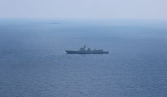 A Chinese People's Liberation Army vessel is seen from an MH-60 helicopter in the South China Sea. An annual report to Congress on China's evolving military capability concluded that the modernization was being driven in part by growing territorial disputes in the East and South China seas, as well as by Beijing's desire to expand its presence and influence abroad. (U.S. Navy)