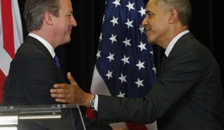 President Barack Obama and British Prime Minister David Cameron shake hands at the end of a news conference at the G7 summit in Brussels, Belgium, Thursday, June 5, 2014. (AP Photo/Charles Dharapak)
