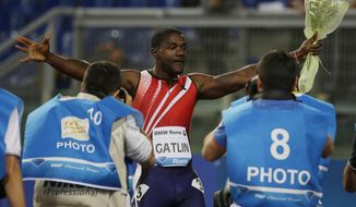 Justin Gatlin, of the U.S., celebrates after winning the men's 100 meters event at the Golden Gala athletics meeting, at Rome's Olympic Stadium, Thursday, June 5, 2014. (AP Photo/Gregorio Borgia)