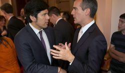 Los Angeles Mayor Eric Garcetti, right, talks with Sen. Kevin de Leon, D-Los Angles, during his first official visit to the Capitol in Sacramento, Calif., June 5, 2014.  Garcetti met with Legislative leaders and Gov. Jerry Brown to make his case for getting state aid to help revitalize California's most populous city. (AP Photo/Rich Pedroncelli)
