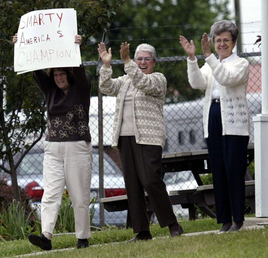 Smarty Jones horse racing fans applaud as the Kentucky Derby and Preakness winner returns to Philadelphia Park Racetrack, in Bensalem Pa., Sunday, June 6, 2004, after finishing second in the Belmont Stakes on Saturday.  (AP Photo/Joseph Kaczmarek)