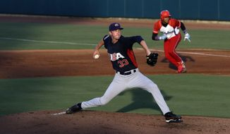 United States pitcher Erick Fedde (33) winds up during the second inning of an exhibition baseball game against Cuba in Cary, N.C., Monday, July 22, 2013. (AP Photo/Gerry Broome)