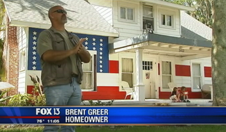 Brent Greer, of Bradenton, Fla., has painted his house like the American flag to protest his local government. (My Fox 13)