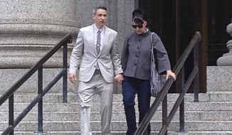 "Beastie Boys rapper Adam ""Ad-Rock""  Horovitz leaves federal court in Manhattan with his wife Kathleen Hanna after testifying at a copyright trial stemming from a lawsuit his musical group brought against a beverage maker over the use of five of their songs in a video, in New York in this Tuesday, May 27, 2014, file photo. (AP Photo/Larry Neumeister, file)"