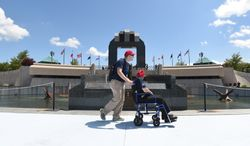 D-Day veteran Roy Herter is escorted through the National D-Day Memorial on Thursday, June 5, 2014,  by Matt Mabe during their visit to the memorial in Bedford, Va. the day before the 70th anniversary of D-Day. (AP Photo/News & Daily Advance, Jill Nance)