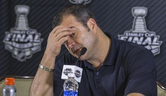 New York Rangers head coach Alain Vigneault takes questions from the media at a news conference in Santa Monica, Calif., Thursday, June 5, 2014. Rangers coach Alain Vigneault challenged all his players to bring their A game to Game 2 of the Stanley Cup final. Not everyone did in the 3-2 loss Wednesday, against the Los Angeles Kings he suggested.(AP Photo/Damian Dovarganes)