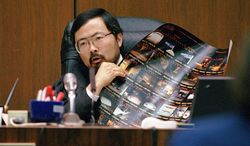 FOR USE SUNDAY, JUNE 8, 2014, AND THEREAFTER - FILE - In this Sept. 7, 1995 file photo, Judge Lance Ito holds up an enlarged proof sheet of crime scene photos during O.J. Simpson's double-murder trial in Los Angeles. In 2014 Ito is still on the Los Angeles Superior Court bench. (AP Photo/Fred Prouser, Pool, File)