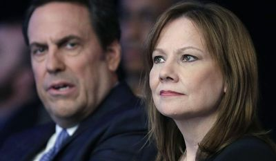 ** FILE ** In this April 15, 2014, file photo, Mary Barra, CEO of General Motors, right, and Mark Reuss, executive vice president of Global Product Development for GM and president of GM America, watch the introduction of new Chevrolet cars at the New York International Auto Show, in New York. (AP Photo/Mark Lennihan, File)