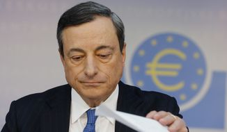 The president of the  European Central Bank Mario Draghi listens to questions during a news conference in Frankfurt, Germany, Thursday,  June 5, 2014. The European Central Bank has cut two key interest rates, one of them into negative territory — a highly unusual step that underlines the urgency of its efforts to keep the eurozone economy from sliding into crippling deflation. It reduced its main interest rate, the refinancing rate, from a record low of 0.25 percent to 0.15 percent. More drastically, it also cut the rate it pays on money deposited by banks from zero to minus 0.1 percent, an unprecedented step for the ECB that aims to push banks to lend money rather than hoard it. (AP Photo/Michael Probst)