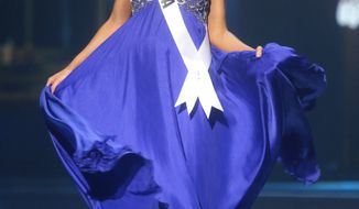 Miss Louisiana USA Brittany Alyson Guidry participates in the evening gown competition during the 2014 Miss USA preliminary competition in Baton  Rouge, La., Wednesday, June 4, 2014. (AP Photo/Gerald Herbert)