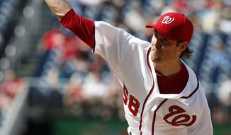 Washington Nationals starting pitcher Doug Fister throws during the first inning of a baseball game against the Philadelphia Phillies at Nationals Park Thursday, June 5, 2014, in Washington. (AP Photo/Alex Brandon)