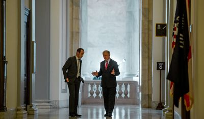 Sen. Jeff Sessions (R-Ala.) speaks to his communications director, Stephen Miller, left, outside his office on Capitol Hill, Washington, D.C., Wednesday, January 15, 2014. (Andrew Harnik/The Washington Times)