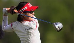 Last year's tournament winner Hee Young Park of South Korea tees off in round 2 of the Manulife Financial LPGA Classic golf tournament Friday, June 6, 2014, in Waterloo, Ontario. (AP Photo/The Canadian Press, Dave Chidley)