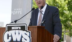 Retired NCAA administrator Dennis Poppe speaks at a ceremony to name a plaza after him near TD Ameritrade, home of the College World Series, in Omaha, Neb., Friday, June 6, 2014. Omaha has honored Poppe who helped forge a long-term agreement to keep the College World Series in the city. (AP Photo/Nati Harnik)