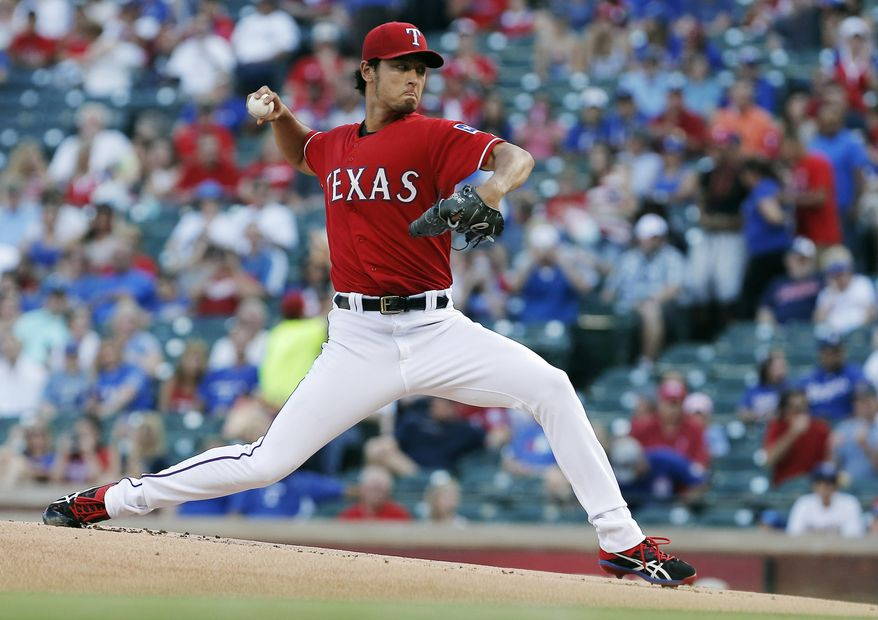 Texas Rangers starting pitcher Yu Darvish throws during the first inning of a baseball game against the Cleveland Indians, Friday, June 6, 2014, in Arlington, Texas. (AP Photo/Brandon Wade)