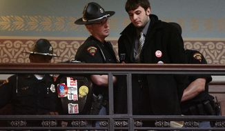FILE - In this June 15, 2011 file photo, protester Jeremy Ryan is removed from the state assembly gallery by Wisconsin State Patrol officers at the state Capitol in Madison, Wis. The Republican Party of Wisconsin is challenging the nomination papers of a well-known Madison protester who is vying to unseat U.S. Rep. Paul Ryan. (AP Photo/Wisconsin State Journal, M.P. King, File)