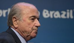 FIFA President Sepp Blatter arrives for a press conference where he talked about the organization and infrastructure of the upcoming World Cup, in Sao Paulo, Brazil, Thursday, June 5, 2014. The World Cup soccer tournament starts on 12 June. (AP Photo/Andre Penner)