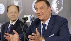 Minnesota Timberwolves team president of basketball operations and new head coach Flip Saunders, right, responds to a question as team owner Glen Taylor, left, listens during a media availability in Minneapolis, Friday, June 6, 2014.  (AP Photo/Ann Heisenfelt)