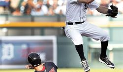 Detroit Tigers second baseman Ian Kinsler jumps after throwing to first base as Boston Red Sox's Grady Sizemore slides into second base on a Jonathan Herrera fielders choice in the second inning of a baseball game in Detroit, Friday, June 6, 2014. Sizemore was out at second base. (AP Photo/Paul Sancya)