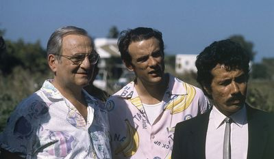 Former Chrysler CEO Lee Iacocca (at left in this 1986 photo) understood the importance of regular vacation breaks in the business world. (AP photo)
