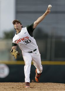 Miami's Andrew Suarez pitches against Bethune-Cookman during the first inning of an NCAA college baseball regional tournament game in Coral Gables, Fla., Friday, May 30, 2014. (AP Photo/Alan Diaz)