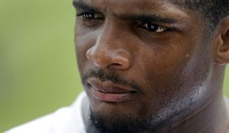 St. Louis Rams defensive end Michael Sam listens to a question while meeting with the media following an organized team activity at the NFL football team's practice facility Friday, June 6, 2014, in St. Louis. (AP Photo/Jeff Roberson)