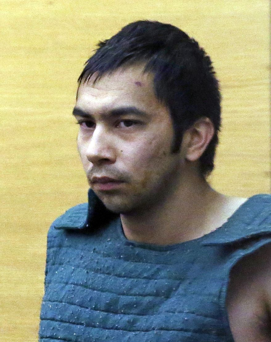 Shooting suspect Aaron Ybarra is led  to a court hearing at a King County Jail courtroom Friday, June 6, 2014, in Seattle. Ybarra was arrested in the killing of a 19-year-old student and wounding of two other young people Thursday at Seattle Pacific University. Police say another student pepper-sprayed and tackled him. (AP Photo/Elaine Thompson)