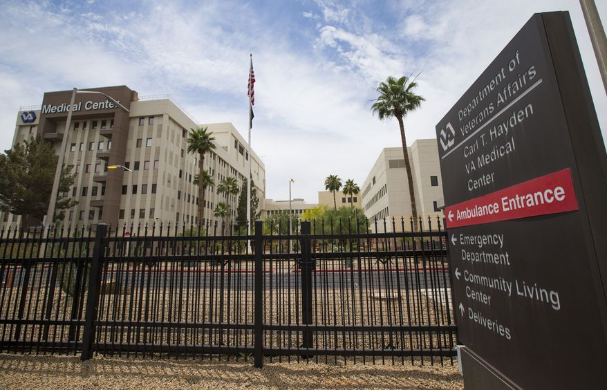 "The Carl T. Hayden VA Medical Center in Phoenix is seen Wednesday May 28, 2014.  About 1,700 veterans in need of care were ""at risk of being lost or forgotten"" after being kept off the official waiting list at the Phoenix veterans hospital, the Veterans Affairs watchdog said Wednesday.  (AP Photo/The Arizona Republic, Michael Chow)  MARICOPA COUNTY OUT; MAGS OUT; NO SALES"