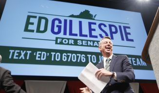 Republican senatorial hopeful Ed Gillespie gestures prepares to address the Virginia GOP Convention in Roanoke, Va., Saturday, June 7, 2014.  The GOP is selecting a nominee to face US Sen. Mark Warner in the fall election.    (AP Photo/Steve Helber)