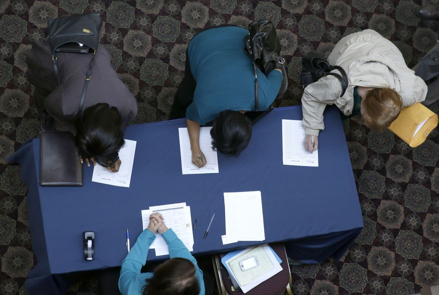 ** FILE ** In this Jan. 22, 2014, file photo, job seekers sign in before meeting prospective employers during a career fair at a hotel in Dallas. (AP Photo/LM Otero)