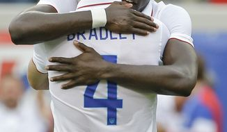 United States's Jozy Altidore, right, celebrates his second goal against Nigeria with teammate Michael Bradley (4) in the second half of an international friendly soccer match in Jacksonville, Fla., Saturday, June 7, 2014. The United States won 2-1. (AP Photo/John Raoux)