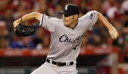 Chicago White Sox starting pitcher Chris Sale throws against the Los Angeles Angels in the fourth inning of a baseball game Saturday, June 7, 2014, in Anaheim, Calif. (AP Photo/Alex Gallardo)