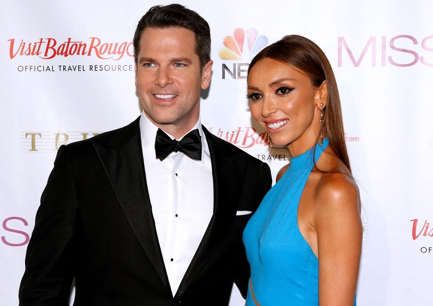 Pageant hosts Thomas Roberts, left, and Giuliana Rancic pose during a red carpet event before the Miss USA 2014 pageant in Baton Rouge, La., Sunday, June 8, 2014. (AP Photo/Jonathan Bachman)
