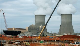 The Plant Vogtle nuclear power plant is shown under construction in Augusta, Georgia in 2012. One of the existing reactors is shown in the background. (Associated Press)