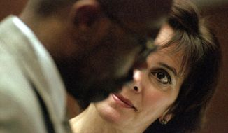In this Sept. 8, 1995 file photo, Marcia Clark talks with co-prosecutor Christopher Darden during arguments about defense exhibits in the O.J. Simpson double-murder case in Los Angeles. (AP Photo/Eric Draper, Pool, File)