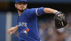 Toronto Blue Jays starter Drew Hutchinson pitches to the St. Louis Cardinals during a baseball game in Toronto, Sunday, June 8, 2014. (AP Photo/The Canadian Press, Frank Gunn)