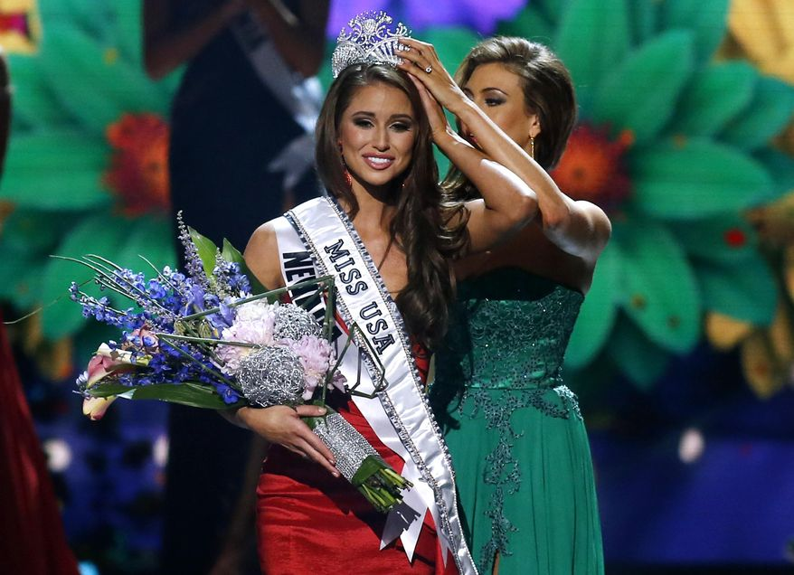 Miss Nevada USA Nia Sanchez is crowned Miss USA during the Miss USA 2014 pageant in Baton Rouge, La., Sunday, June 8, 2014. (AP Photo/Jonathan Bachman)