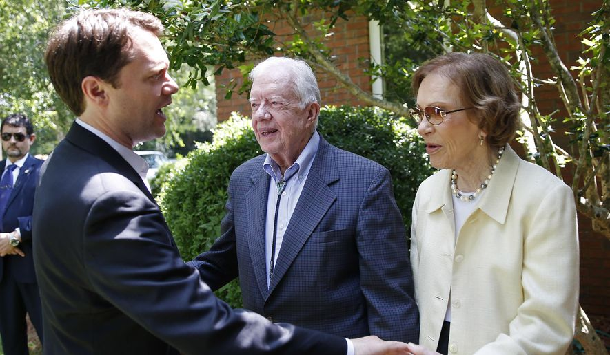 Georgia democratic gubernatorial candidate Jason Carter, left, chats with his grandfather former President Jimmy Carter and grandmother  Rosalynn Carter after attending church in Plains, Ga, Sunday, June 8, 2014. The younger Carter is hoping that a large fundraising effort this weekend will help his campaign. (AP Photo/John Bazemore)