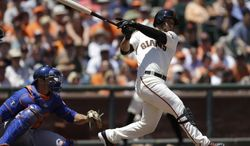 San Francisco Giants' Gregor Blanco swings for a two run double off New York Mets' Zack Wheeler in the second inning of a baseball game Sunday, June 8, 2014, in San Francisco. (AP Photo/Ben Margot)