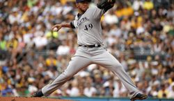 Milwaukee Brewers starting pitcher Yovani Gallardo (49) delivers during the first inning of a baseball game against the Pittsburgh Pirates in Pittsburgh Sunday, June 8, 2014. (AP Photo/Gene J. Puskar)