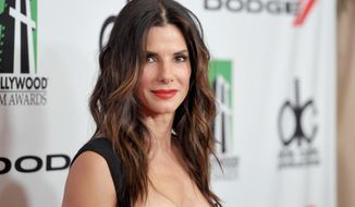 ** FILE ** In this Oct. 21, 2013, file photo, Sandra Bullock arrives at the 17th Annual Hollywood Film Awards Gala at the Beverly Hilton Hotel in Beverly Hills, Calif. (Photo by John Shearer/Invision/AP, file)