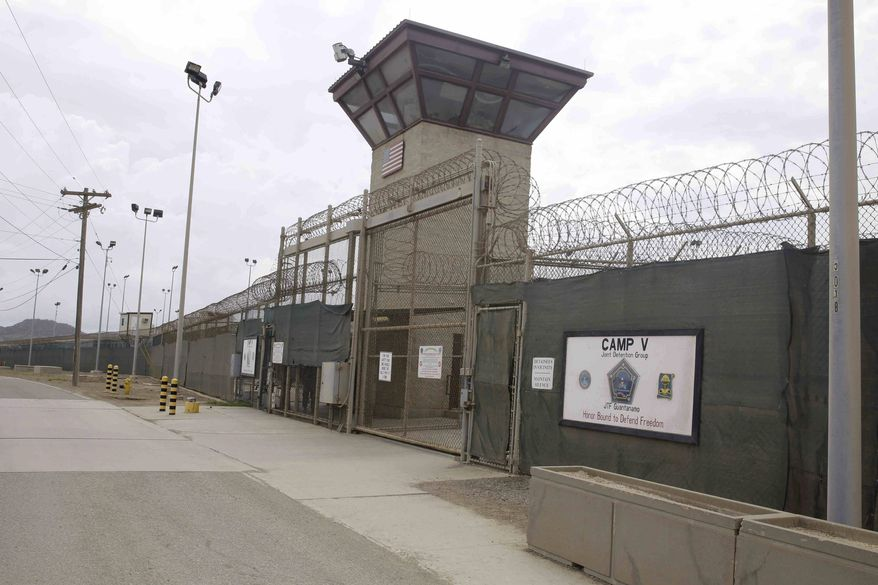 ** FILE ** The entrance to Camp 5 and Camp 6 at the U.S. military's Guantanamo Bay detention center, which President Barack Obama has pledged to close amid opposition in Congress, at Guantanamo Bay Naval Base, Cuba, Saturday, June 7, 2014. (AP Photo/Ben Fox)