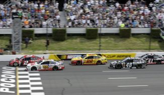 Brad Keselowski (2) and Dale Earnhardt Jr. (88) race across the line on a late race restart during the NASCAR Sprint Cup series Pocono 400 auto race, Sunday, June 8, 2014, in Long Pond, Pa. Dale Earnhardt Jr. won and Keselowski was second. (AP Photo/Mel Evans)