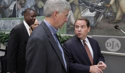 "Judge Gerald E. Rosen, Chief U.S. District judge, right, speaks with Gov. Rick Snyder, center, as Detroit Emergency Manager Kevyn Orr, left, enters in front of part of Diego Rivera's Detroit Industry mural before a news conference at the Detroit Institute of Arts in Detroit, Monday, June 9, 2014. General Motors, Ford and Chrysler are driving into Detroit's bankruptcy reorganization by pledging $26 million to help support retiree pensions while keeping the city's art treasures off the auction block, officials announced Monday. The money will go to city pensions as part of its $100 million commitment to what's being called a ""grand bargain"" to resolve the largest public bankruptcy in U.S. history. (AP Photo/Paul Sancya)"
