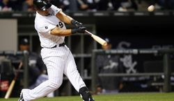 Chicago White Sox first baseman Jose Abreu hits a two-run home run against the Detroit Tigers during the fifth inning of a baseball game on Monday, June 9, 2014, in Chicago. (AP Photo/Jeff Haynes)